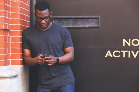 man distracted by cell phone