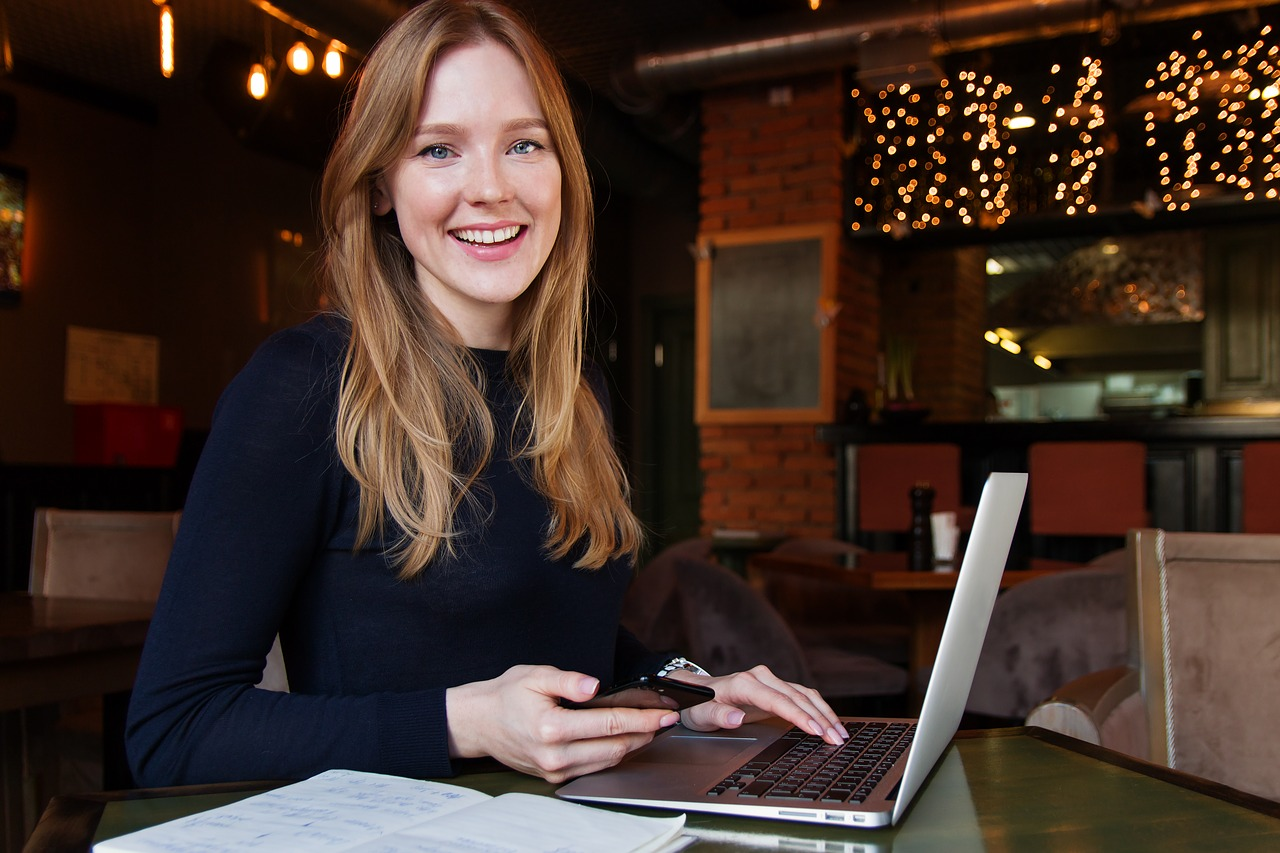 Smiling business woman at laptop